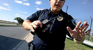Police officer approaching a FAA Drone Pilot about drones.