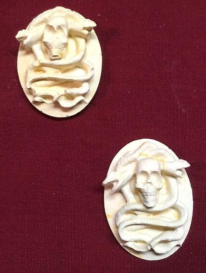 2 Snake-Skull Medallions