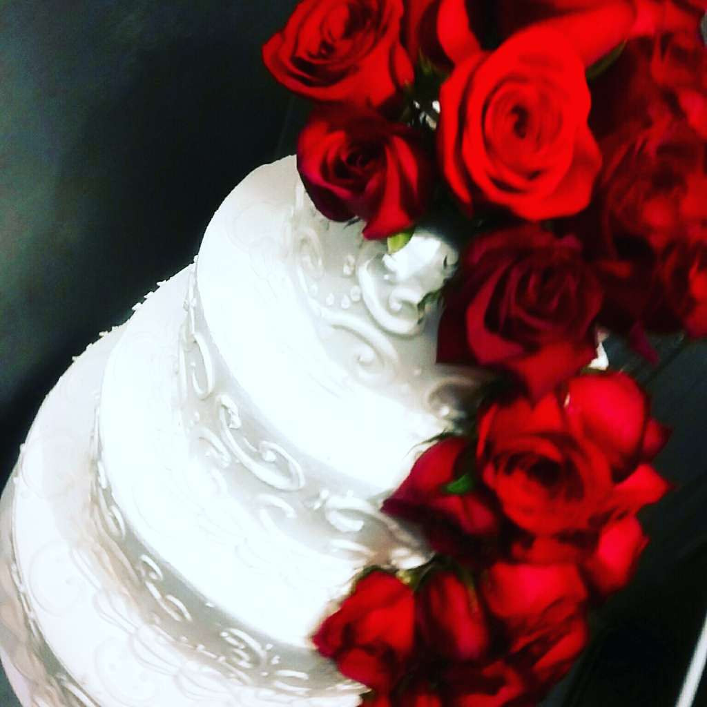 wedding cake with lots of roses