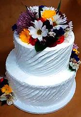 white anniversary cake with flowers.jpg