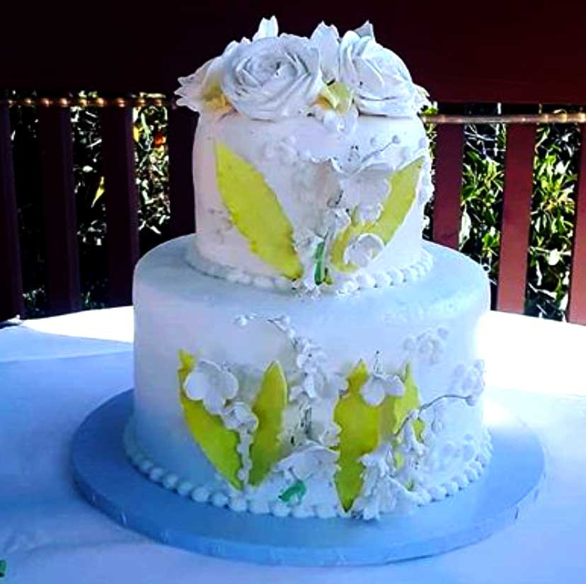 white and yellow wedding cake