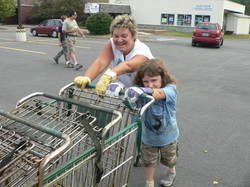 Bev and Mo driving the carts back home