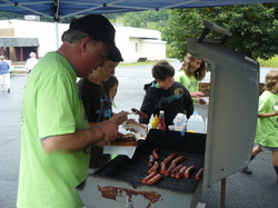 Jim and Jenna grilling dogs from Main St Market