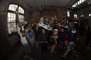 Participants in Freedom Skate waving their skateboards - a great time! Image via Freedom Skate.