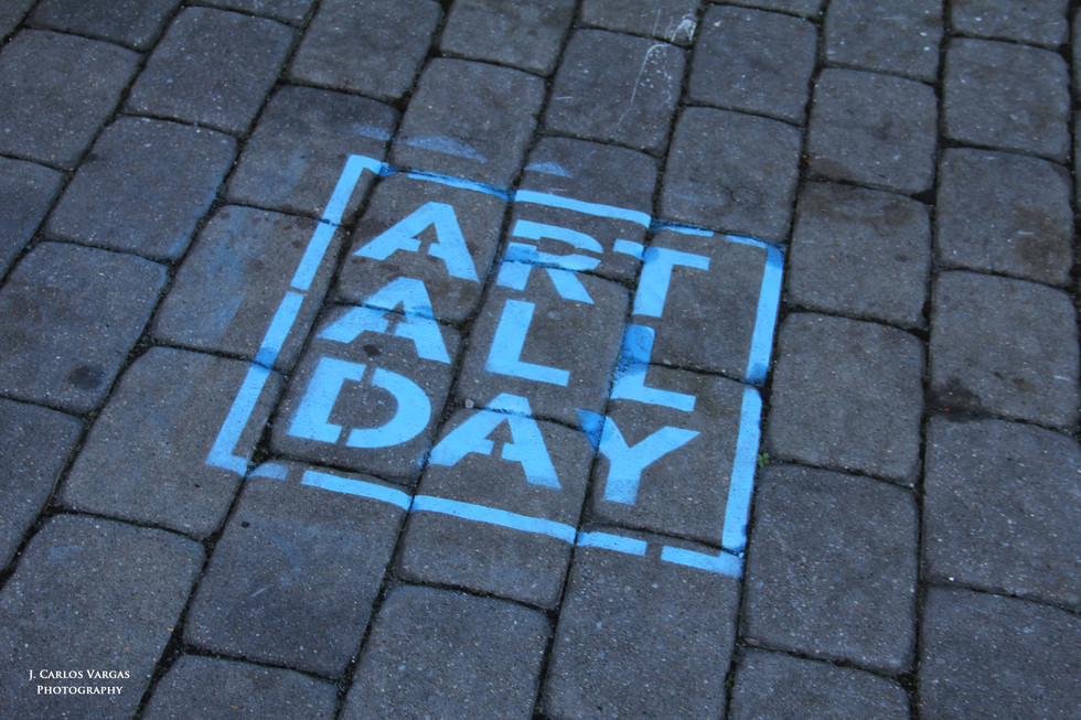 The Art All Day logo on the downtown pavement. Photo: Carlos Vargas.