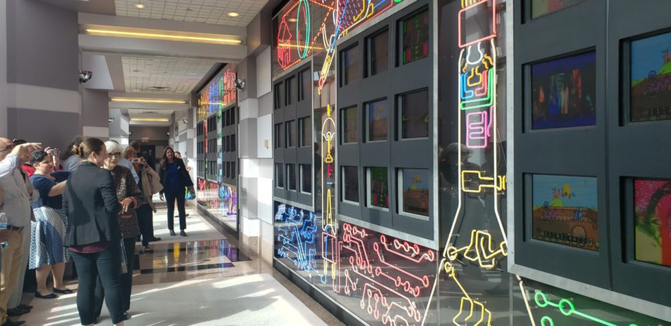 """Nam June Paik's """"PBS (1963-2000)"""" sculpture, with neon symbols and 50 video monitors featuring live video feeds and video work by the artist, was recently restored. Photo: Trenton Daily."""