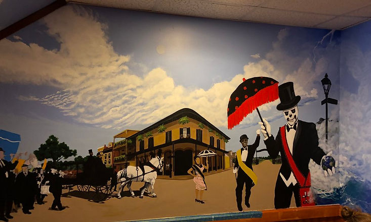 Artist Kwenci Jones, who created the amazing New Orleans-inspired murals inside the restaurant, will be painting live. (Photo credit: Hidden Trenton.)