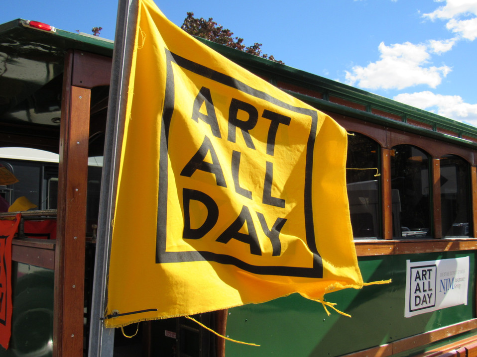 A yellow Art All Day flag flies on a trolley, AAD 2018. Photo: Rob Keephart.