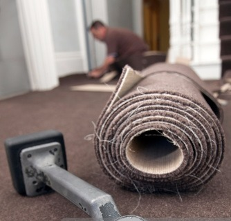Rolled carpet and knee kicker