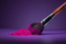 makeupbrushwithpowder.jpg