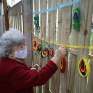 Senior decorating the sukkah