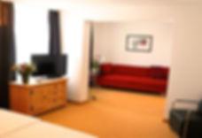 camera-junior-suite-salotto3.jpg