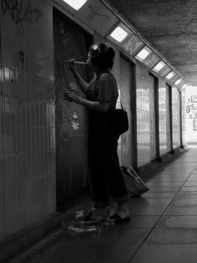 Artist painting in the subway