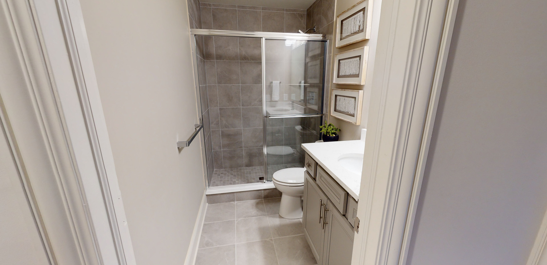 Simple real estate photography bathroom photo with white accents and white vanity