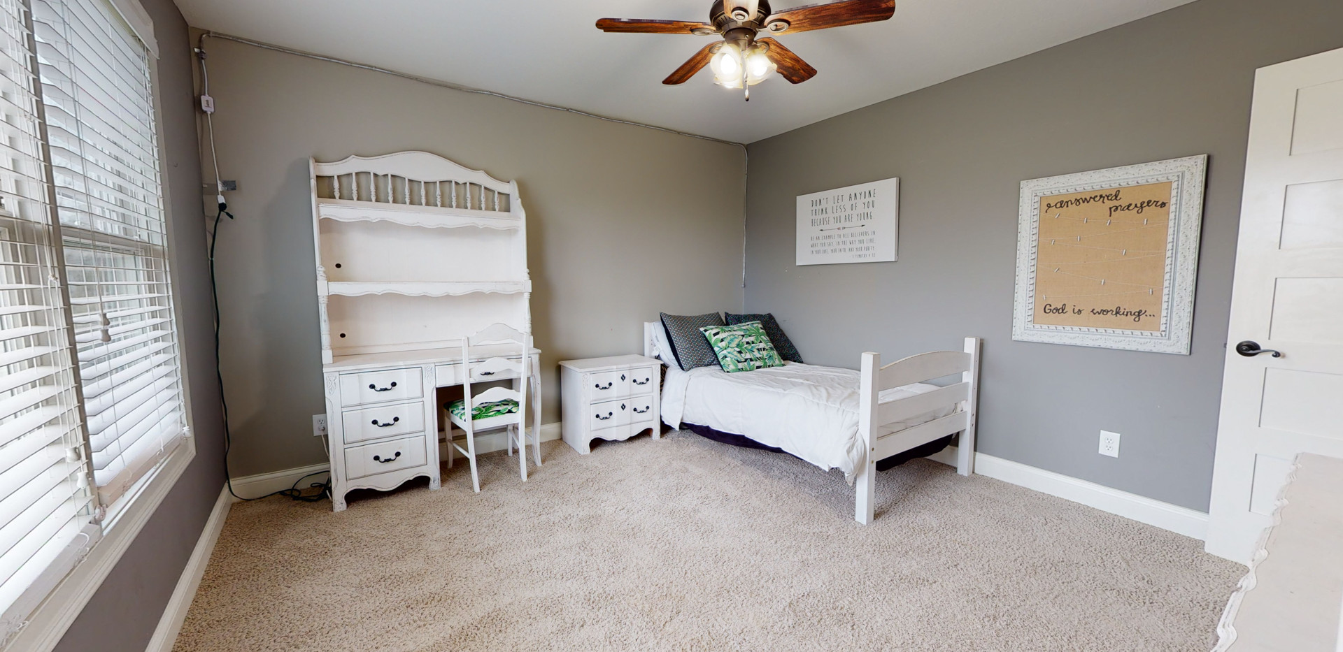 Kid's bedroom with white furniture and modern grey walls.