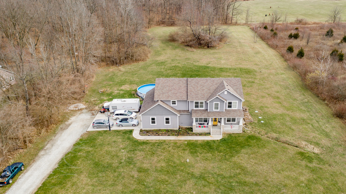 45 degree angle of Exterior dron photo by The One Package Real Estate Photography
