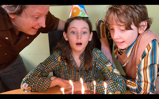 A Future Wish A blows out candles with D