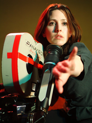 Burton adjusts the actors from behind the camera