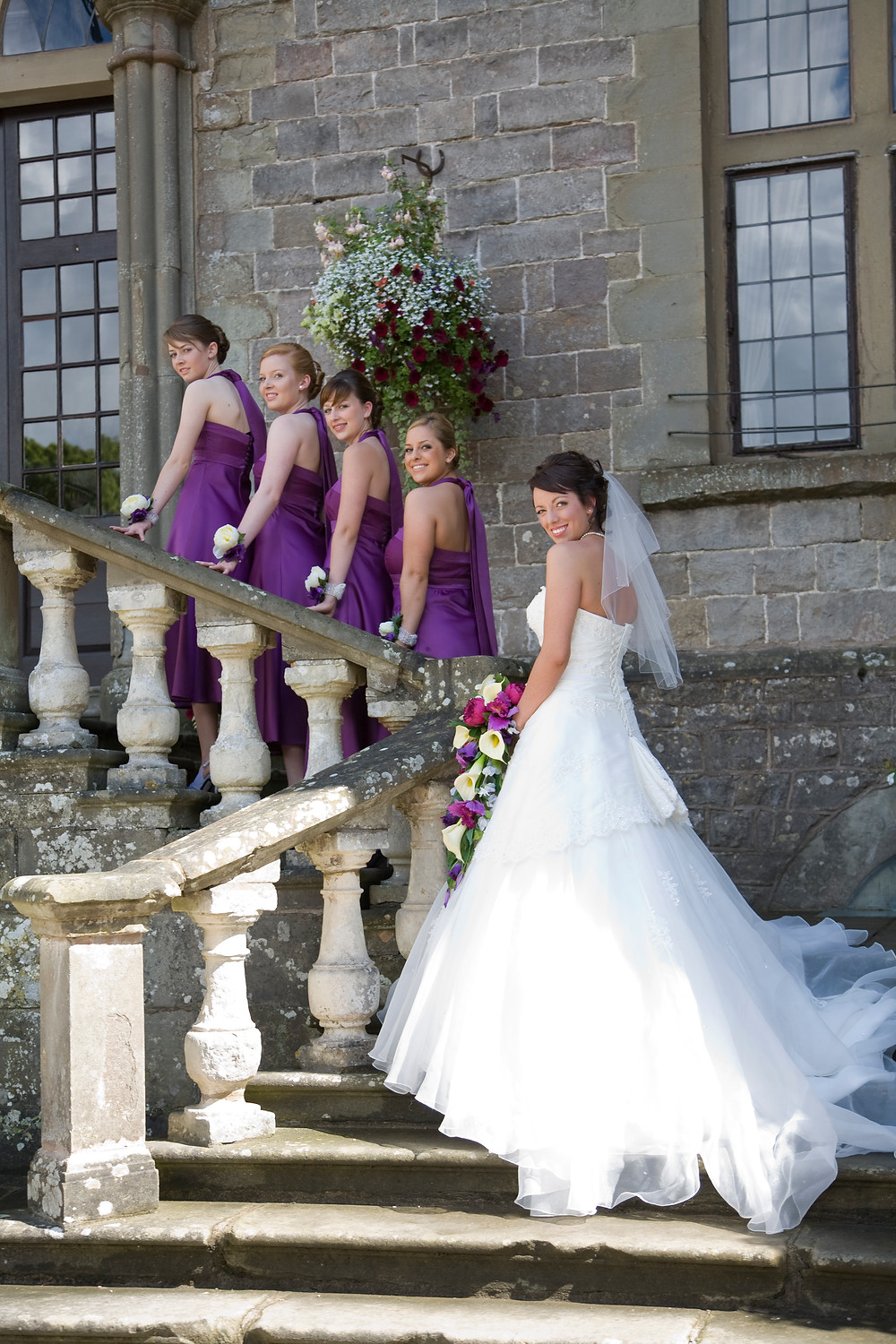 Clearwell Castle bridal party on stairs