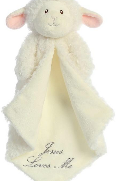 Manta de peluche con carita de oveja.