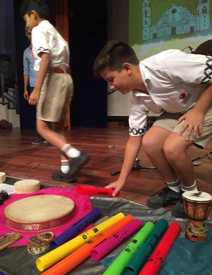 kid trying the boomwhacker.jpg