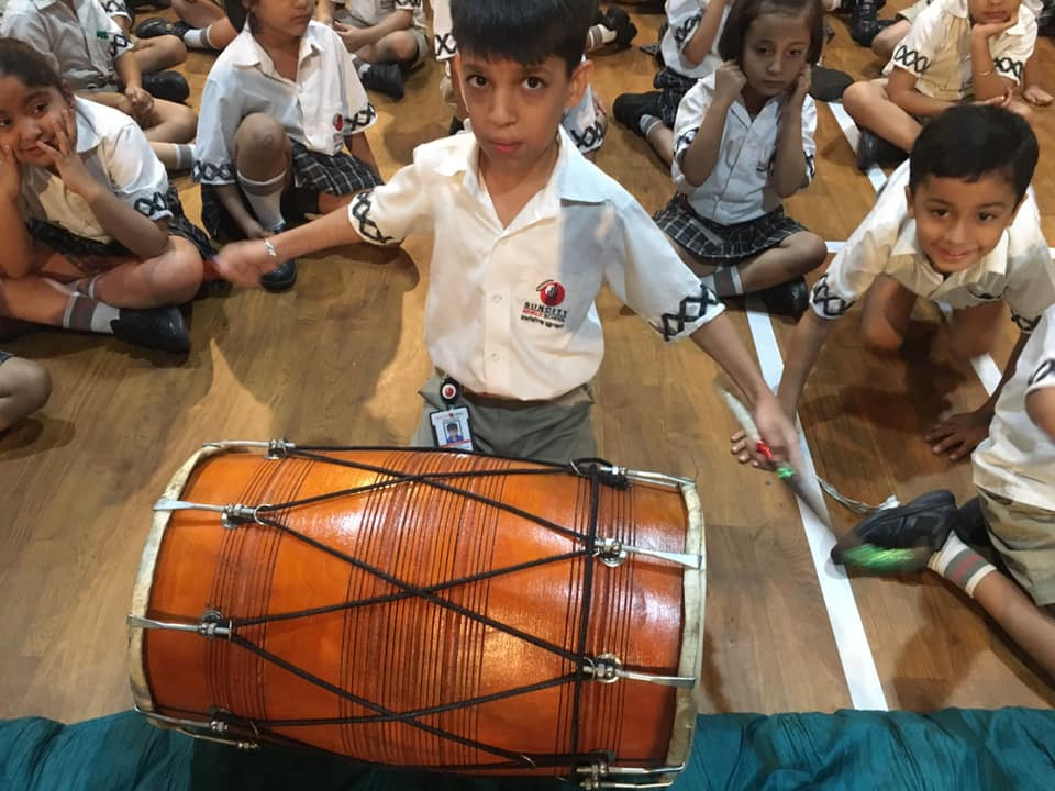 kid wiht the dhol.jpg