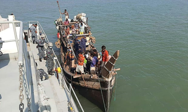 A Bangladeshi navy vessel takes a boat carrying Rohingya refugees alongside. Photograph: AFP via Getty Images