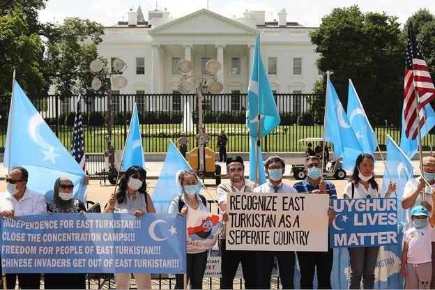 People rally outside the White House to urge the United States to end trade deals with China and take action to stop the oppression of the Uighurs and other Turkic peoples on Aug. 14. | Chip Somodevilla/Getty Images