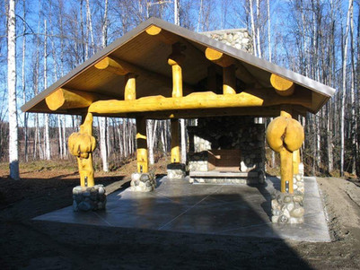 Log pavilion with stone work