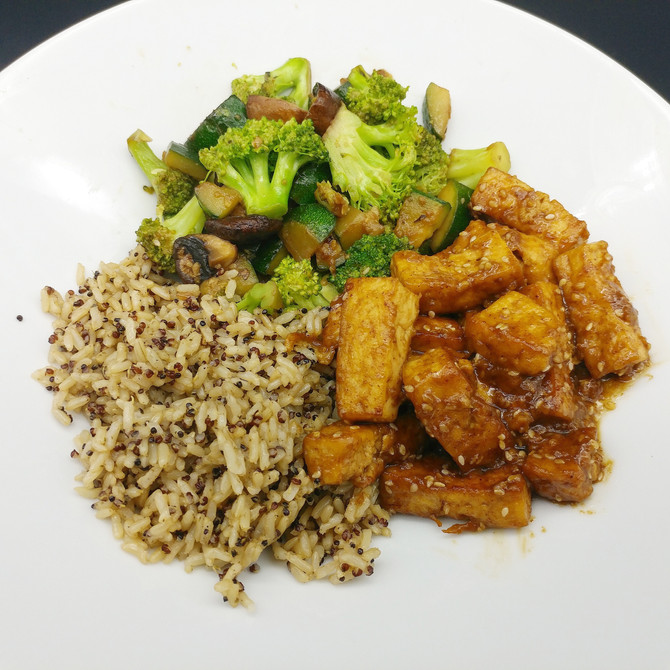 Tofu with Almond Teriyaki sauce together with veggie stir fry and brown rice and quinoa