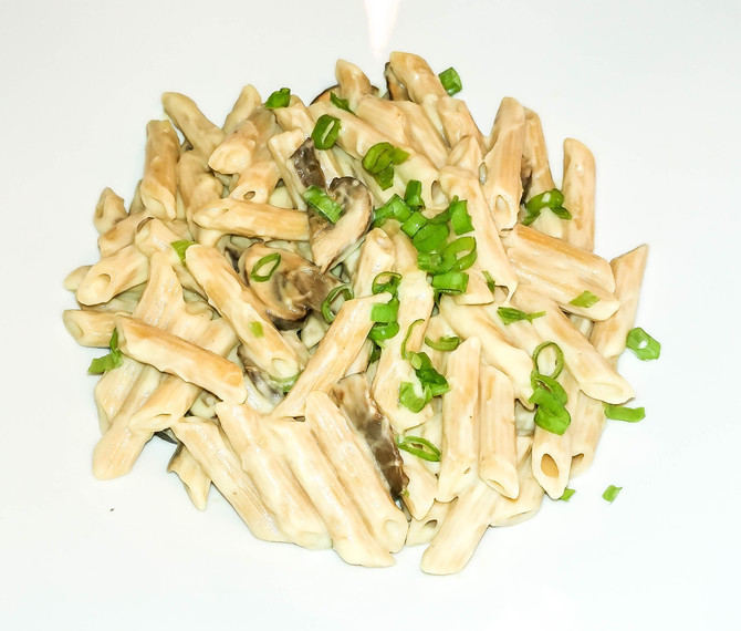 Penne with Cauliflower and Mushroom  Alfredo sauce. Vegan