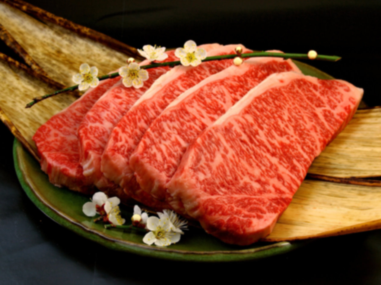 Japanese Wagyu Beef steak cuts with plum