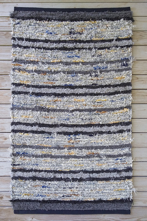 Gray striped handwoven rug with color accents