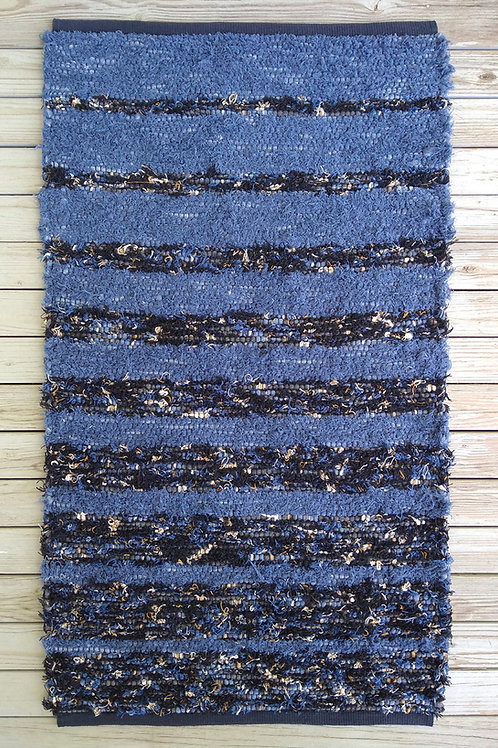 Handwoven rug with blue, black, gold, and cream stripes