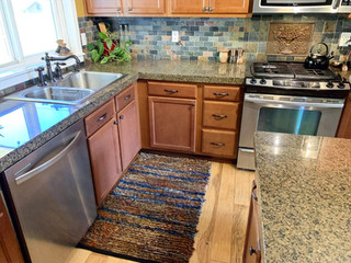 """""""Kathy spent time going through all of her color options to help me find just the rug I was looking for to use in my kitchen. It is beautiful and fits the space perfectly. I love it!"""" -Katie L."""