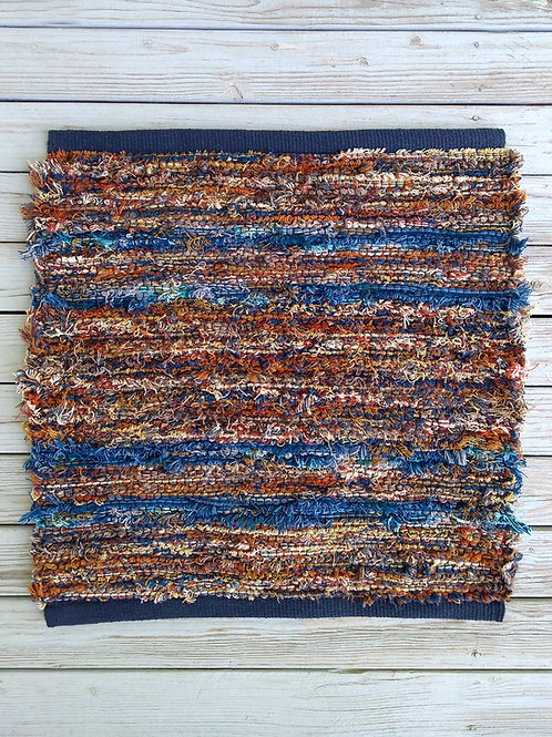 Handwoven rug in brown and blue