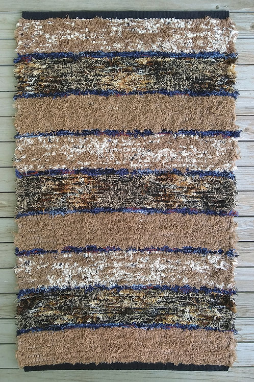 Handwoven rug in browns and dark blue