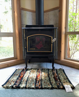 """""""We have really enjoyed our new rug created by Kathy. It offers so much rich color and texture to the room, and we love that it is made with Pendleton woolen mill ends. The quality of Kathy's weaving and finishing is excellent!"""" -Carol B."""