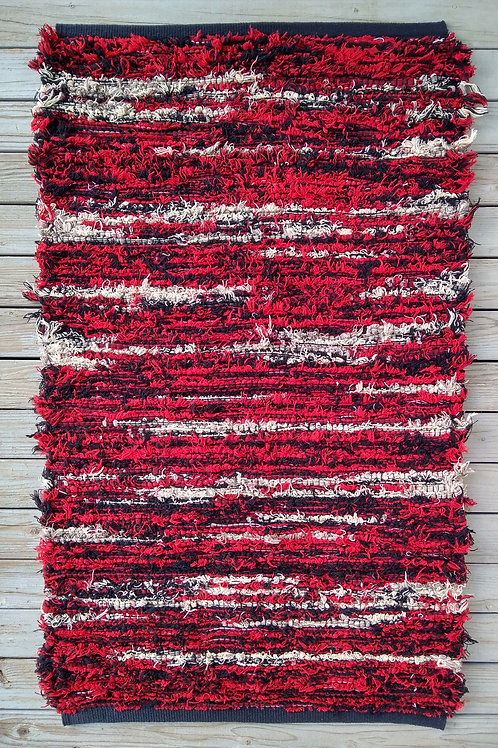 Red, white, and black handwoven rug