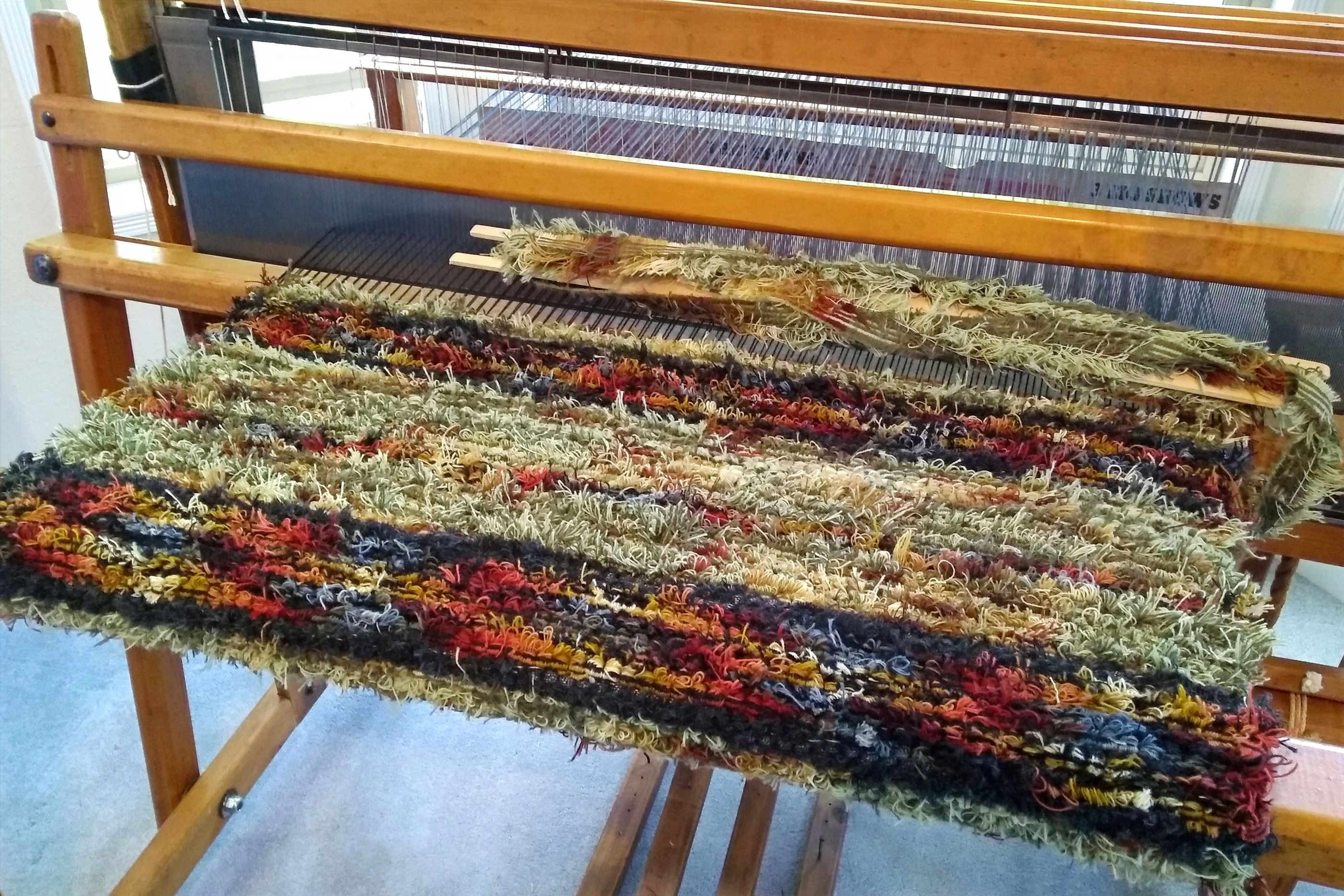 Weaving a rug on one of my antique floor looms.
