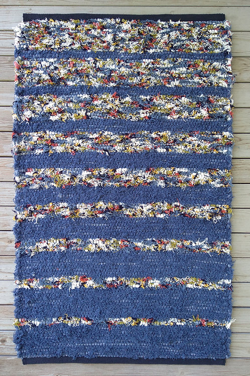 Handwoven rug in blue and multi-colored stripes