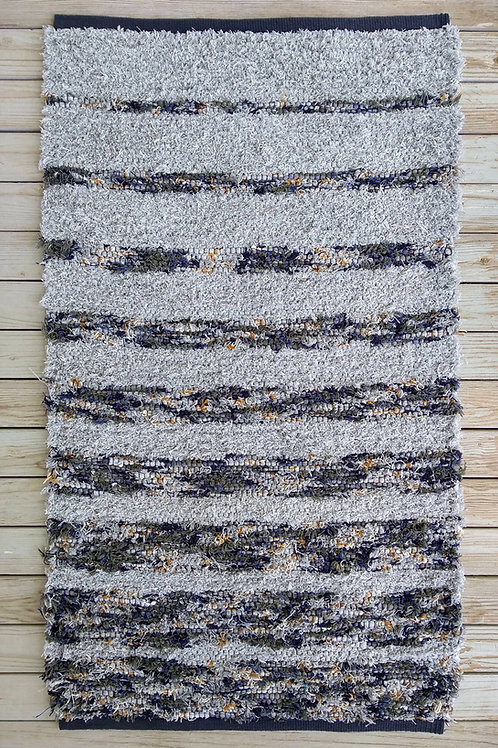 Handwoven rug with gray and multi-colored stripes