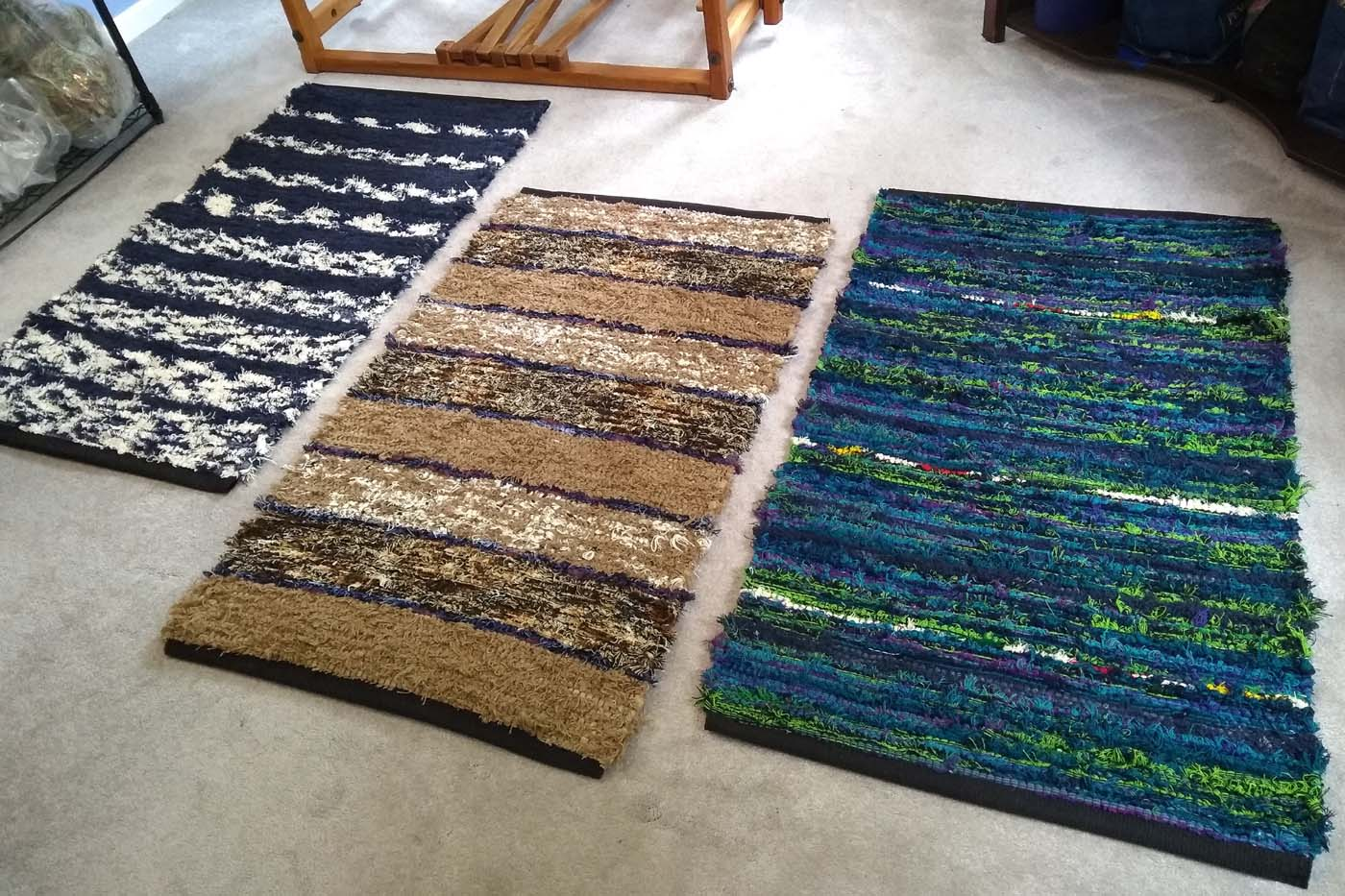 Three rugs are off the loom and ready for hemming.
