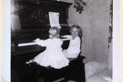 Playing my Mom's piano with my friend Doodie.