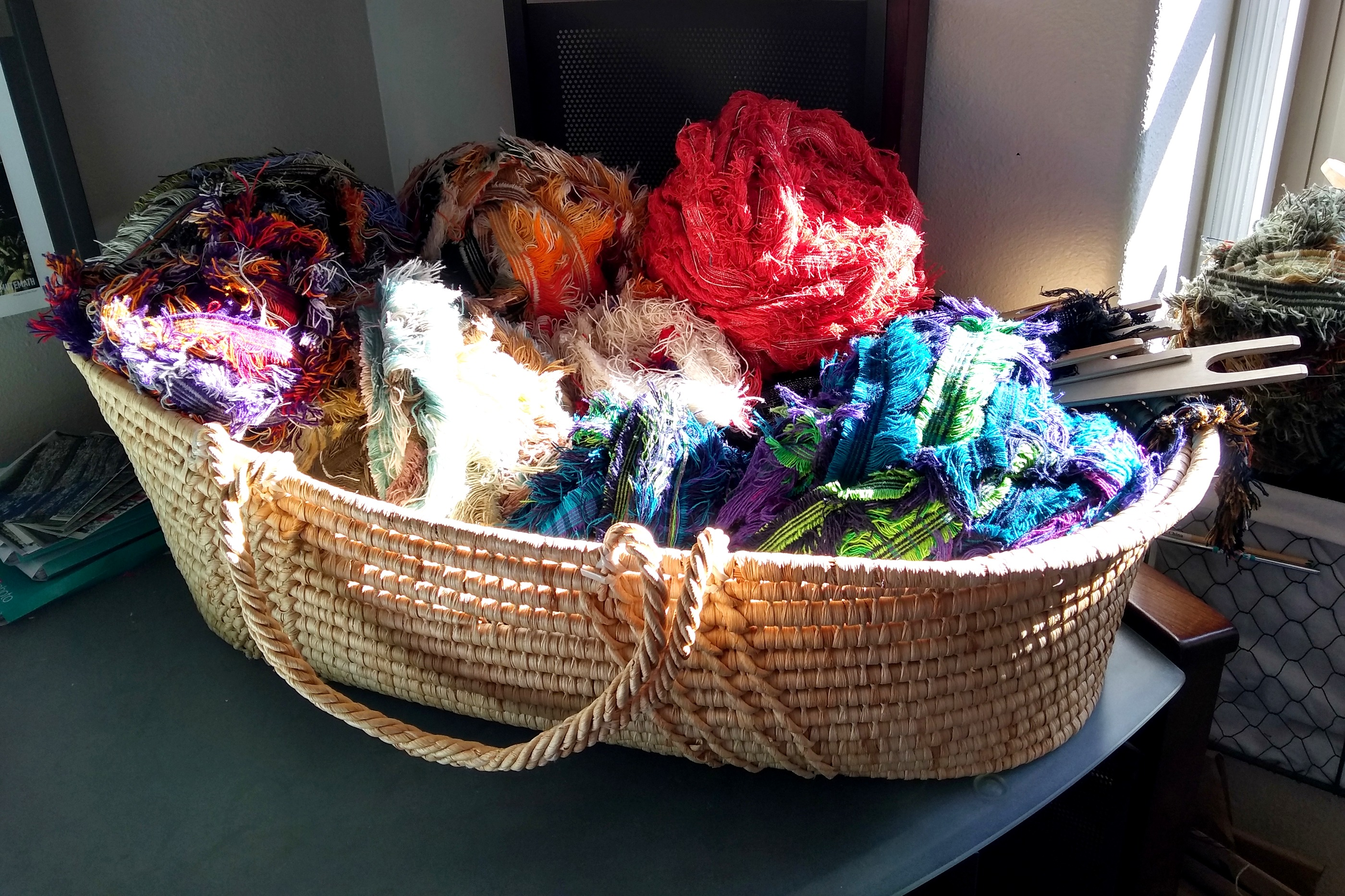 My basket of Pendleton wool selvage is ready for weaving a rug.