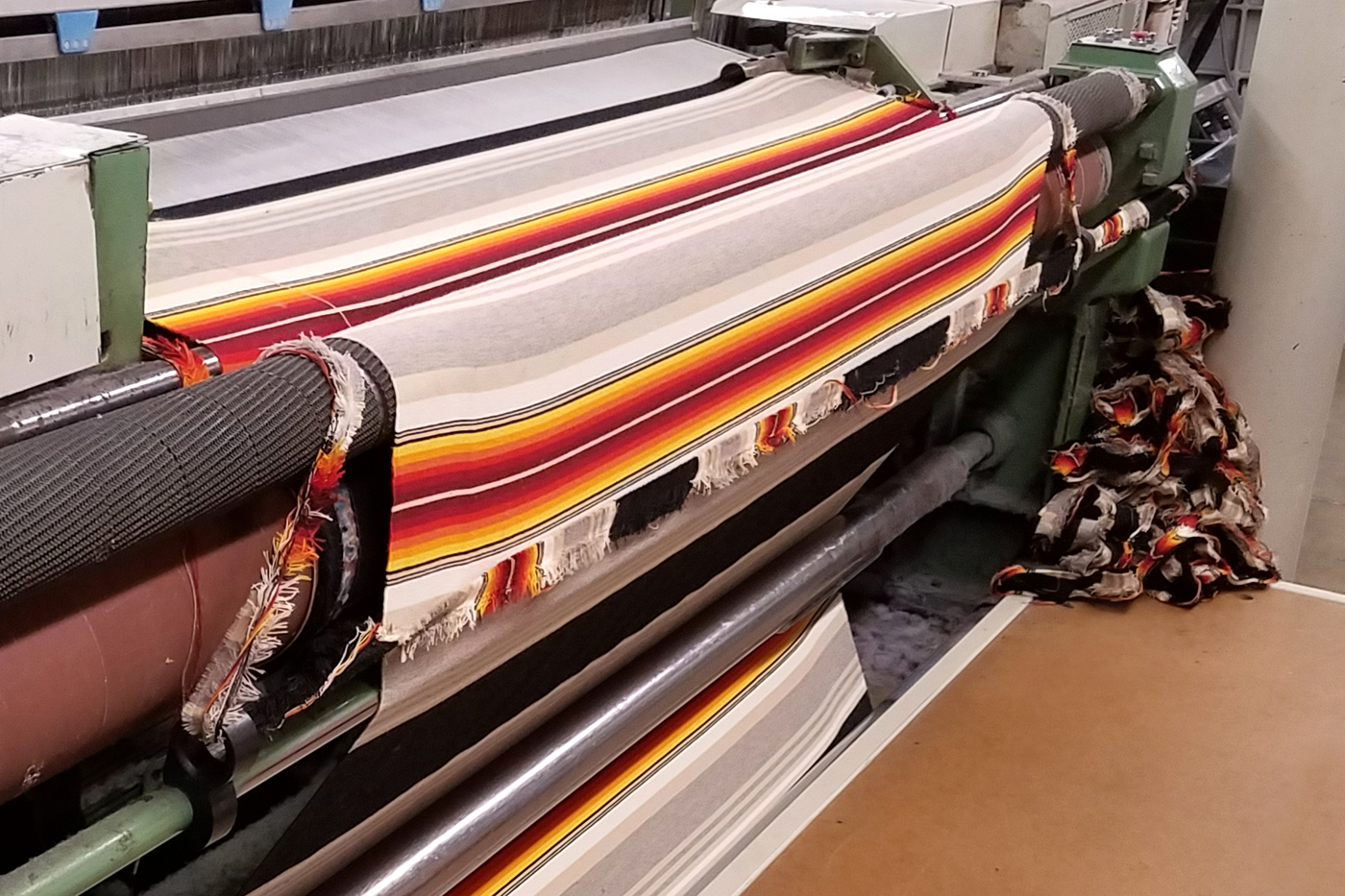 Selvage (loom waste) is trimmed off the sides of Pendleton blankets woven in Pendleton, Oregon.