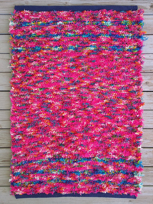 Handwoven rug in pink and turquoise