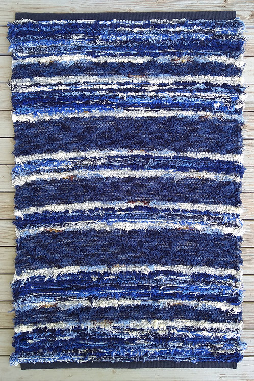 Handwoven rug with blue and white stripes
