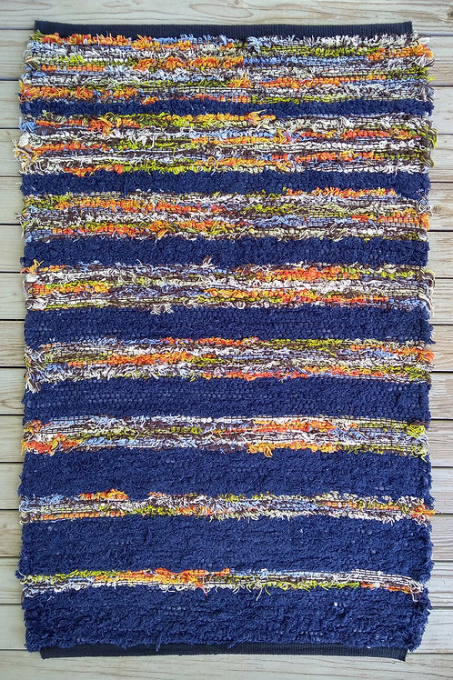 Handwoven rug with blue and multi-colored stripes