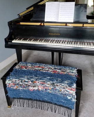 """""""I put one of Kathy's smaller rugs on our piano bench, and it's allowing me to play longer and more often than ever! Never has playing the piano been so comfortable. And it looks so much better than the cheesy little pillow I used to use."""" -Eric S."""